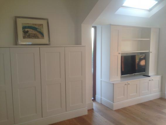 Beautiful bespoke wardrobes and Television cabinet finished in Farrow and Ball p